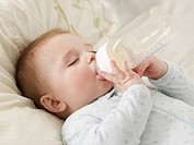 Baby Boy Sucking Milk Bottle