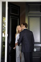 Husband kissing wife before leaving for work