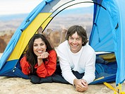 Couple lying in tent, portrait