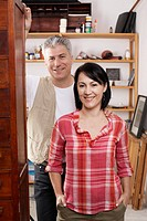 Portrait of mature couple at doorway (thumbnail)