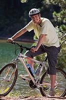 Portrait of smiling man on mountain bike