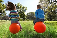 Kids bouncing on hoppity horses (thumbnail)