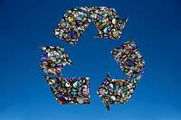 Recycling symbol formed by recycled tin cans