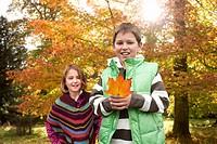 Boy and girl holding mushroom
