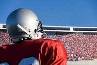 Football player looking at crowd in stadium