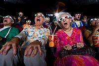 Movie audience in 3D glasses, making faces, low angle view