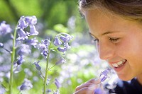 Girl smelling bluebell flower