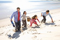 Parents with children walking on beach (thumbnail)