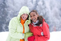 Portrait of happy women laughing in snow