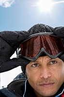 Mature man wearing ski goggles, close_up
