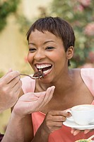 Woman sharing dessert outdoors