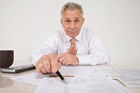 Accountant Pointing to Bottom Line
