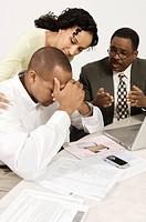 Accountant Giving Couple Bad News