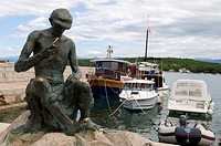 Fishing man sculpture, harbour of Njivice, Krk Island, Kvarner Gulf, Croatia
