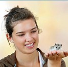 Girl with Chinese Hamster on hand, Cricetulus barabensis, Cricetulus griseus
