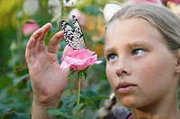 Young Girl Looking at a Butterfly