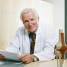 Doctor Reviewing Patient Record
