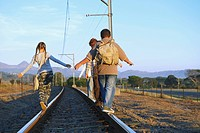 Children Walking on Railroad Tracks