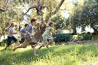Children Running in a Meadow