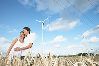 Couple in Field with Windmills