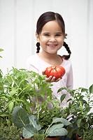 Girl Holding Tomato