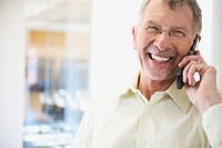 Amused Businessman on Cell Phone