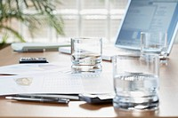 Business documents on table