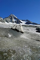 Melting ice in front of the peak of the Grossglockner, National Park Hohe Tauern, Tyrol, Austria