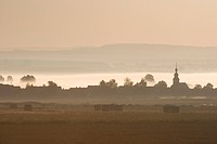 Village in morning fog, Rossdorf, Hesse, Germany
