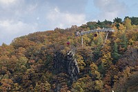 Autumnal landscape, Rosstrappe granite rock and gondola lift, Thale, Saxony-Anhalt, Germany