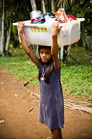 Child Carrying Box in the Head, Terra Preta Community, Cuieiras River, Amazônia, Manaus, Amazonas, Brazil