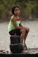 Seating woman, Castanha Community, Negro River, Novo Airão, Amazonas, Brazil