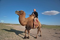 Caucasian traveller rides a two-humped camel, north central Mongolia The two-humped camel is the Bactrian Camel Camelus bactrianus, native to the step...