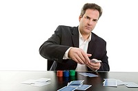 Man sitting at a table dealing cards, poker