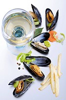 Dutch specialty: mussels with french fries and a glass of white wine
