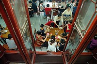 People enjoying traditional Aozhao noodle in Kunshan Aozao Restaurant, Shanghai, China
