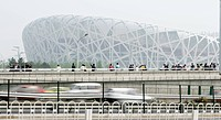 Tourists view Bird´s Nest from a pedestrian passage, Beijing, China