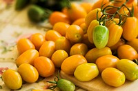 Orange Plum Tomatos on a Cutting Board. Solanum lycopersicon.