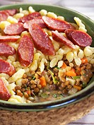 Lentil stew with spaetzle noodles and salami