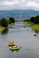 Rafters drift the Okanagan River Channel at Penticton, in the Okanagan region of British Columbia, Canada