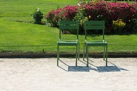 France, Paris, metal chairs set side by side in park (thumbnail)