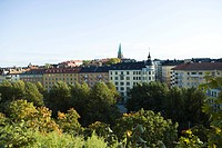 Sweden, Sodermanland, Stockholm, buildings rising above treetops