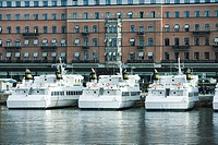 Sweden, Stockholm, yachts docked in canal front of apartment buildings