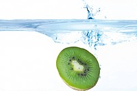 Half a kiwi plunging into water