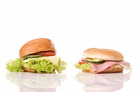 Turkey sandwich and ham sandwich with lettuce, tomato and cucumber