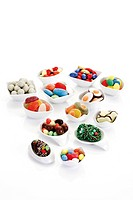 Variety of candy easter eggs and sweets in porcelain bowl