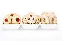 Linzer Augen, Vanillekipferl and Husarenkrapferl cookies in white bowls