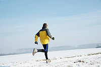 Man jogging in a wintery landscape