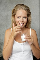 Woman, young, yogurt, smiling, eating, candy, finger, half portrait, ,