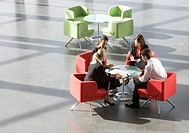 Four business colleagues having a meeting in an office building